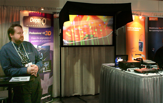 Lightspeed's President Chris Ward with the new DepthQ<sup>&reg;</sup> HDs3D-1 projector, combined with the DepthQ<sup>&reg;</sup> Polarization Modulator and a Stewart silver 3D screen at Siggraph 2010